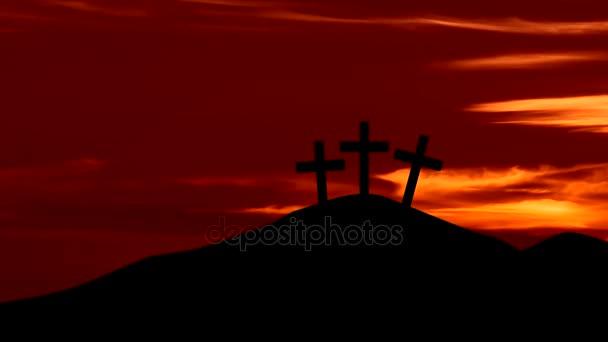 Three crosses on the hill at sunrise