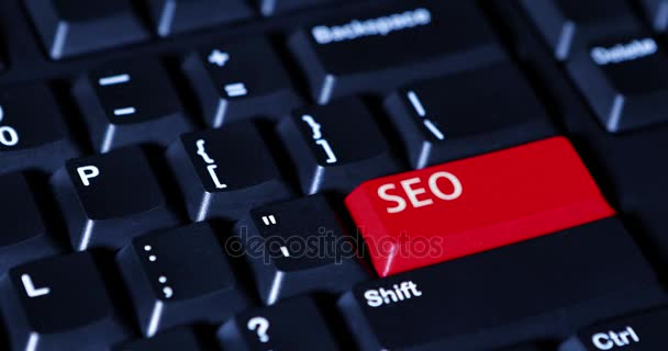 Hand pressing red seo button