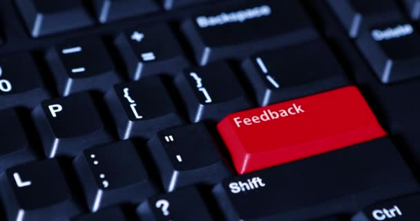 Hand pushing red feedback button