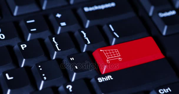 Hand pushing red shopping cart button