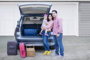 Family with car ready for holiday