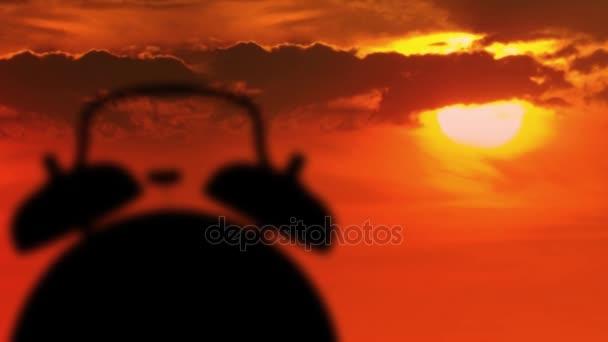 Budík zvoní v době východu slunce