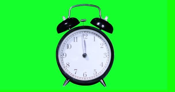 Wecker klingelt um zwölf Uhr