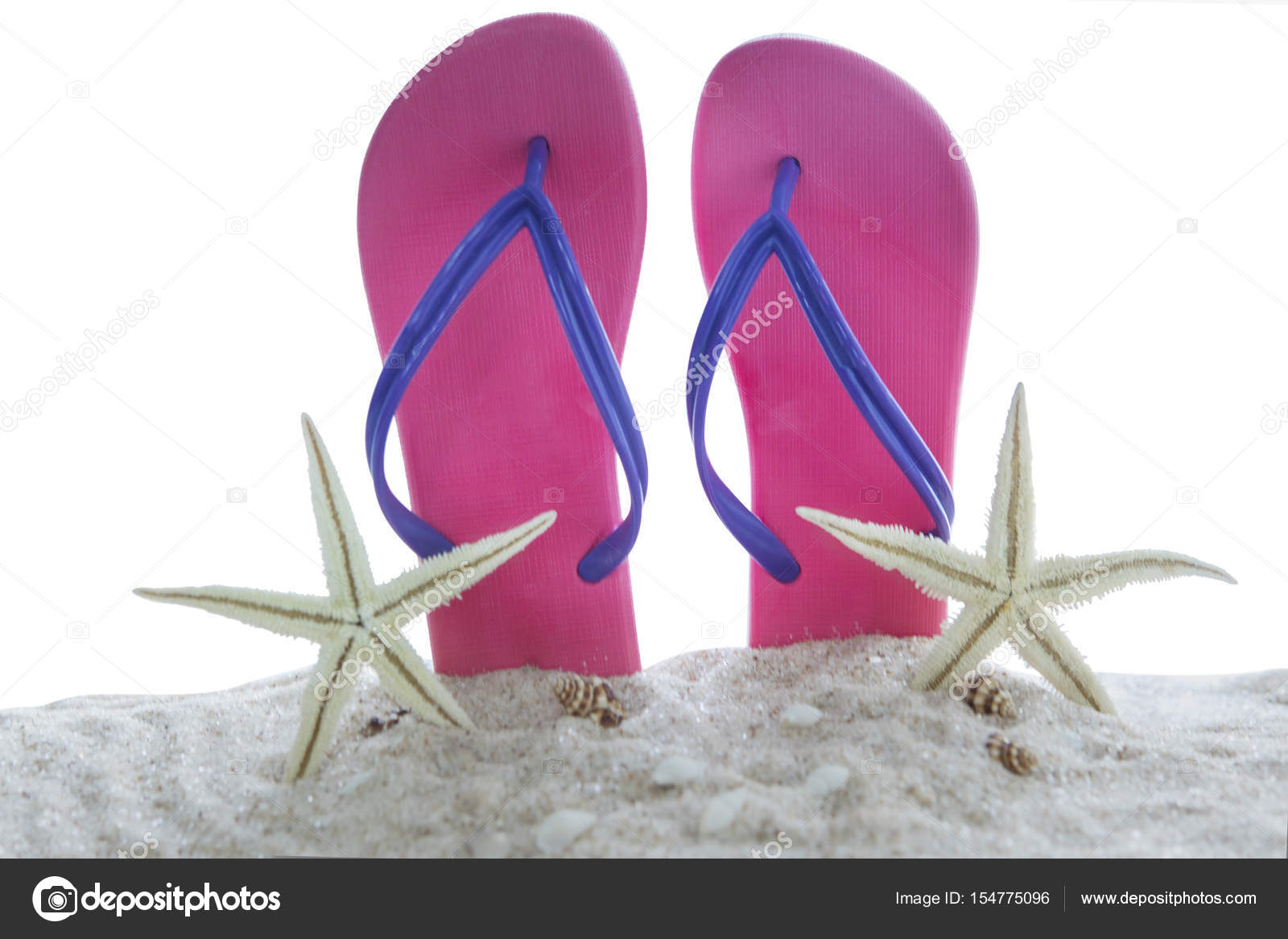 663b49f211c2 Summer vacation concept. Two sandals with sea stars and seashells on the white  beach sand