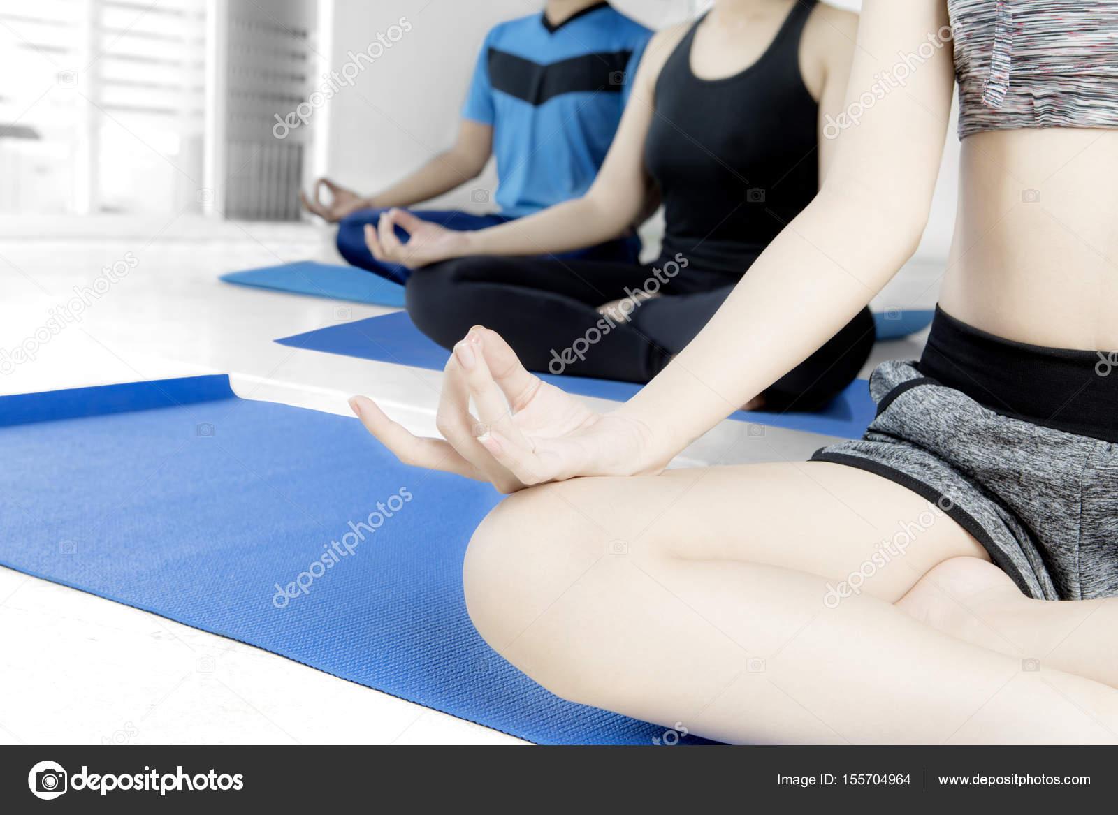 three people practicing yoga stock photo realinemedia 155704964