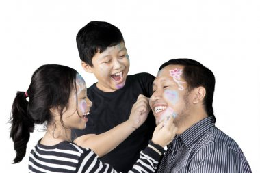 Little children drawing on their father