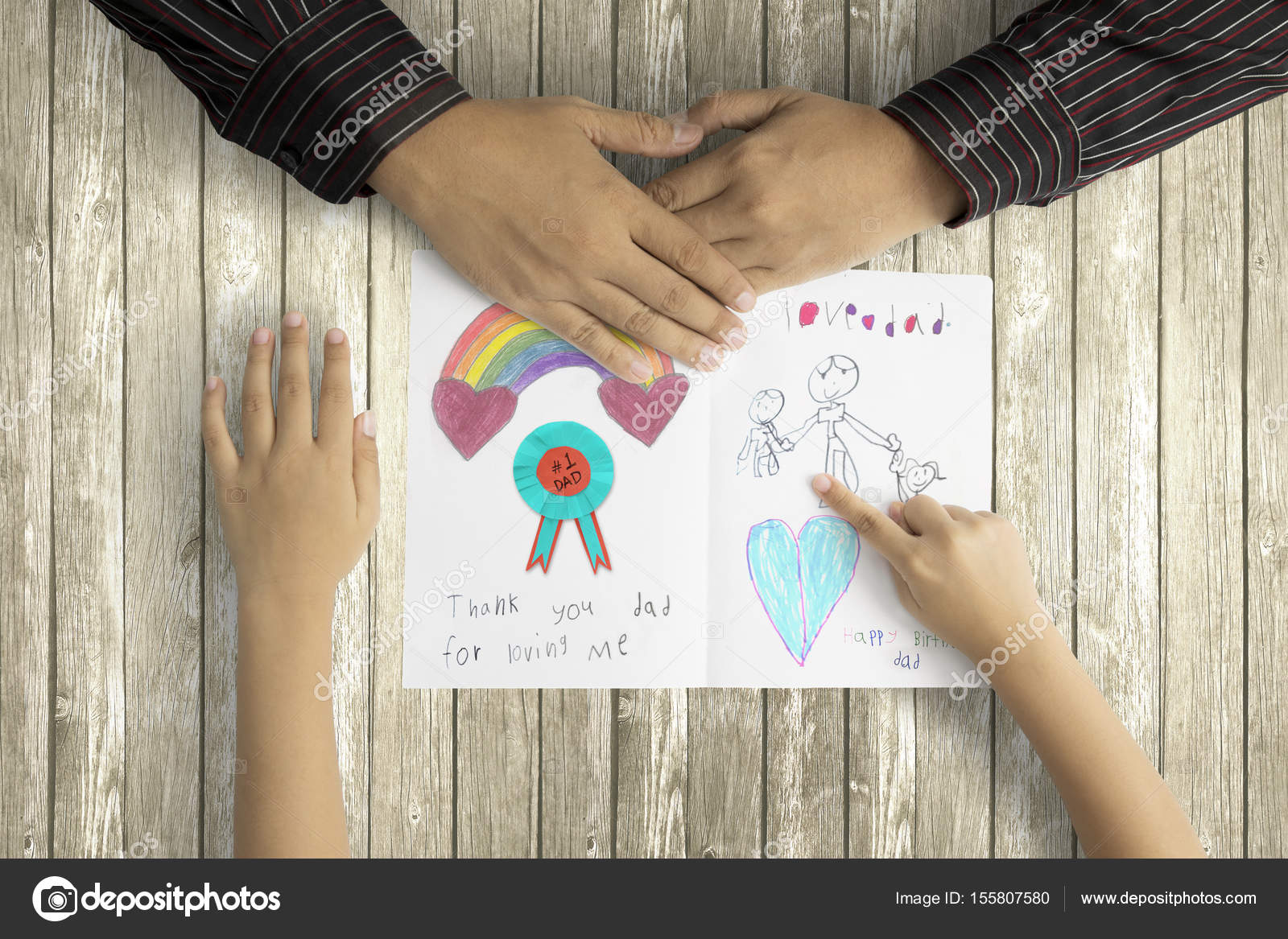 Child Showing Picture To Father On Greeting Card Stock Photo