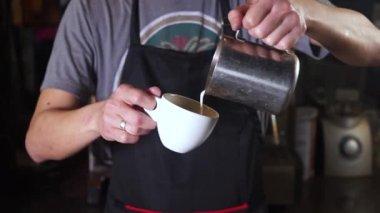 Barista prepares a cup of coffee
