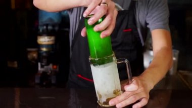 Bartender pouring beer into glass