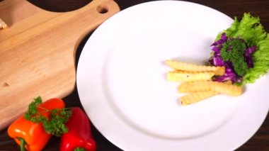 Chef serving tasty sandwich on plate