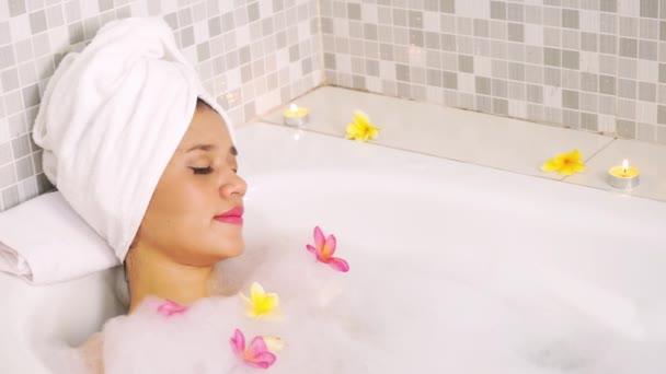 Woman enjoying beauty spa treatment on bathtub