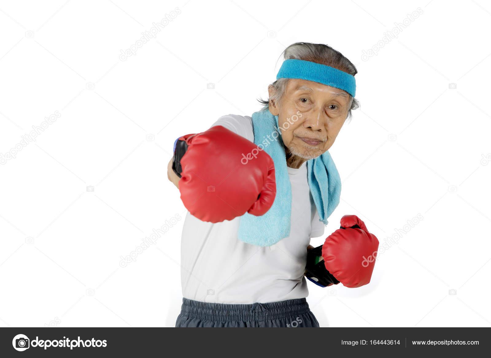 Old man punching at the camera ⬇ Stock Photo, Image by © realinemedia  #164443614