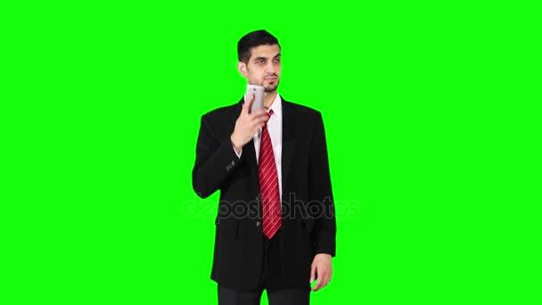 Handsome businessman speaking on cellphone