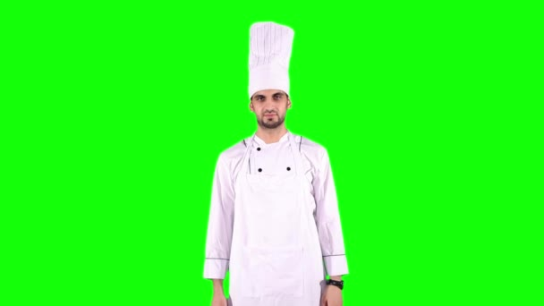 Koch mit Spachtel überquerte Hände