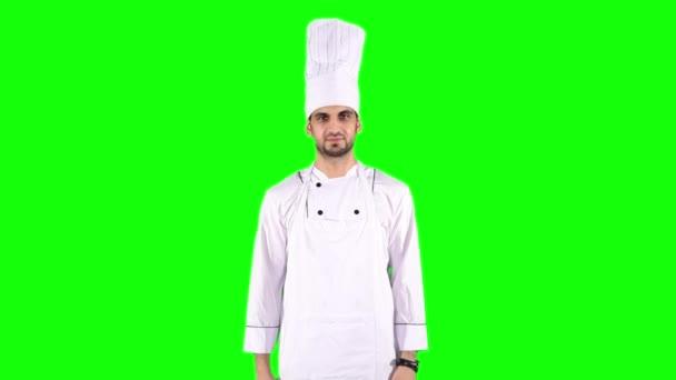 Kaukasische Koch zeigt zwei Daumen oben