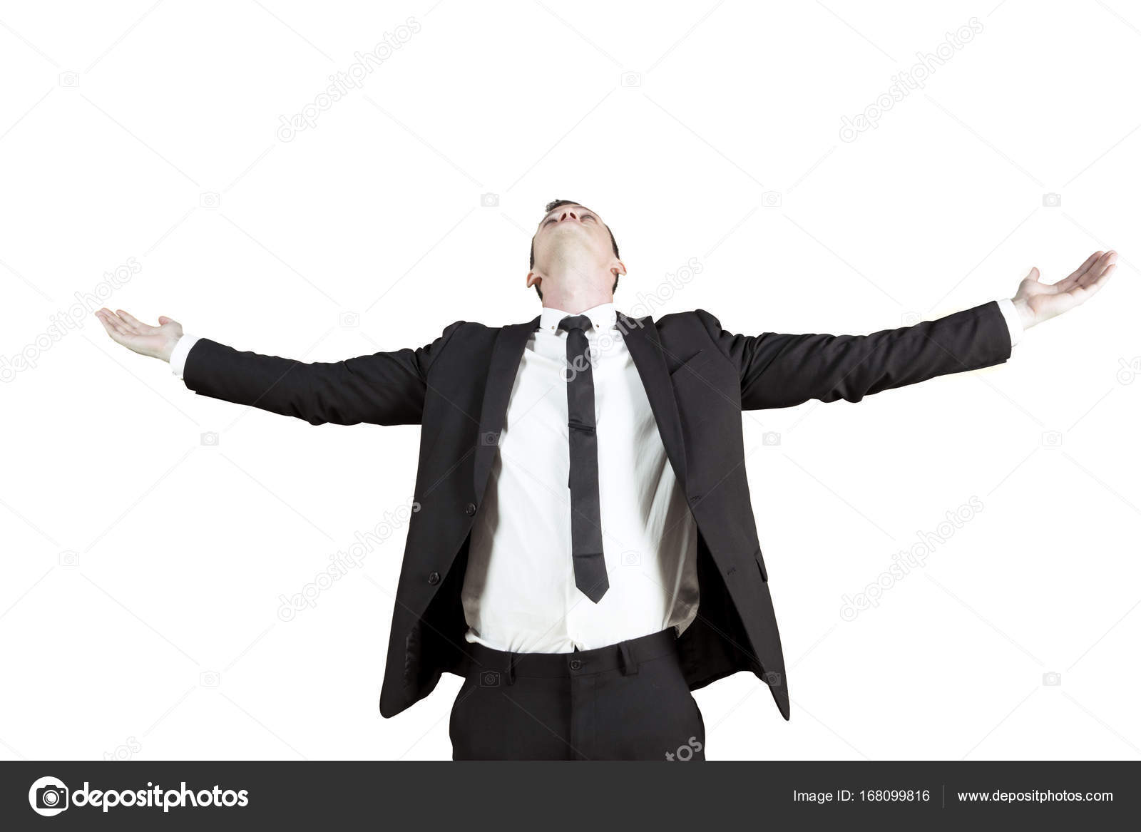 successful businessman with outstretched arms stock photo