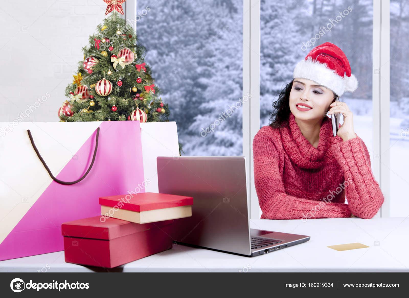 Woman buying Christmas gifts online — Stock Photo © realinemedia ...