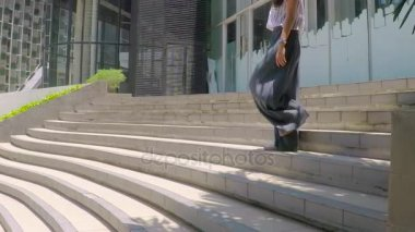 Businesswoman with cellphone on stair