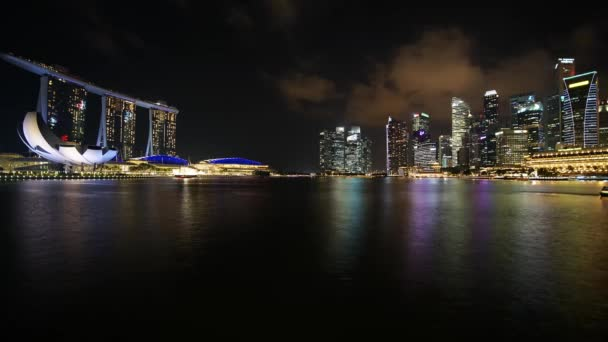 Singapore - November 27, 2017: Timelapse of Singapore cityscape in central business district with skyscrapers, Marina Sands Hotel, and ArtScience Museum at night. Shot in 4k resolution