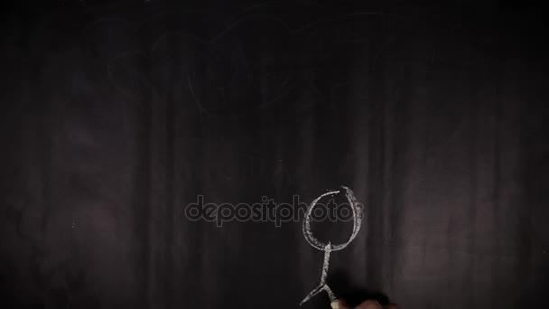 Časosběrné záběry z ruční žena otazníky pomocí křídou na tabuli