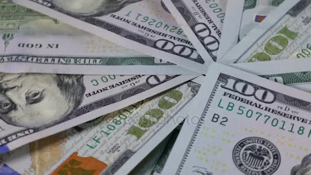 Closeup of a stack of one hundred American dollar money spinning on the table