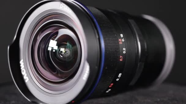 JAKARTA - Indonesia. December 12, 2017: Closeup of Ultra Wide Angle slr camera lens over dark background