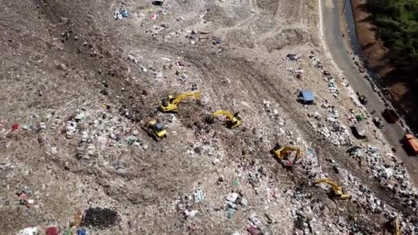 Pollution concept. Aerial footage of Bantar Gebang landfill or trash dump with backhoe and scavengers in Bekasi, Indonesia. Shot in 4k resolution
