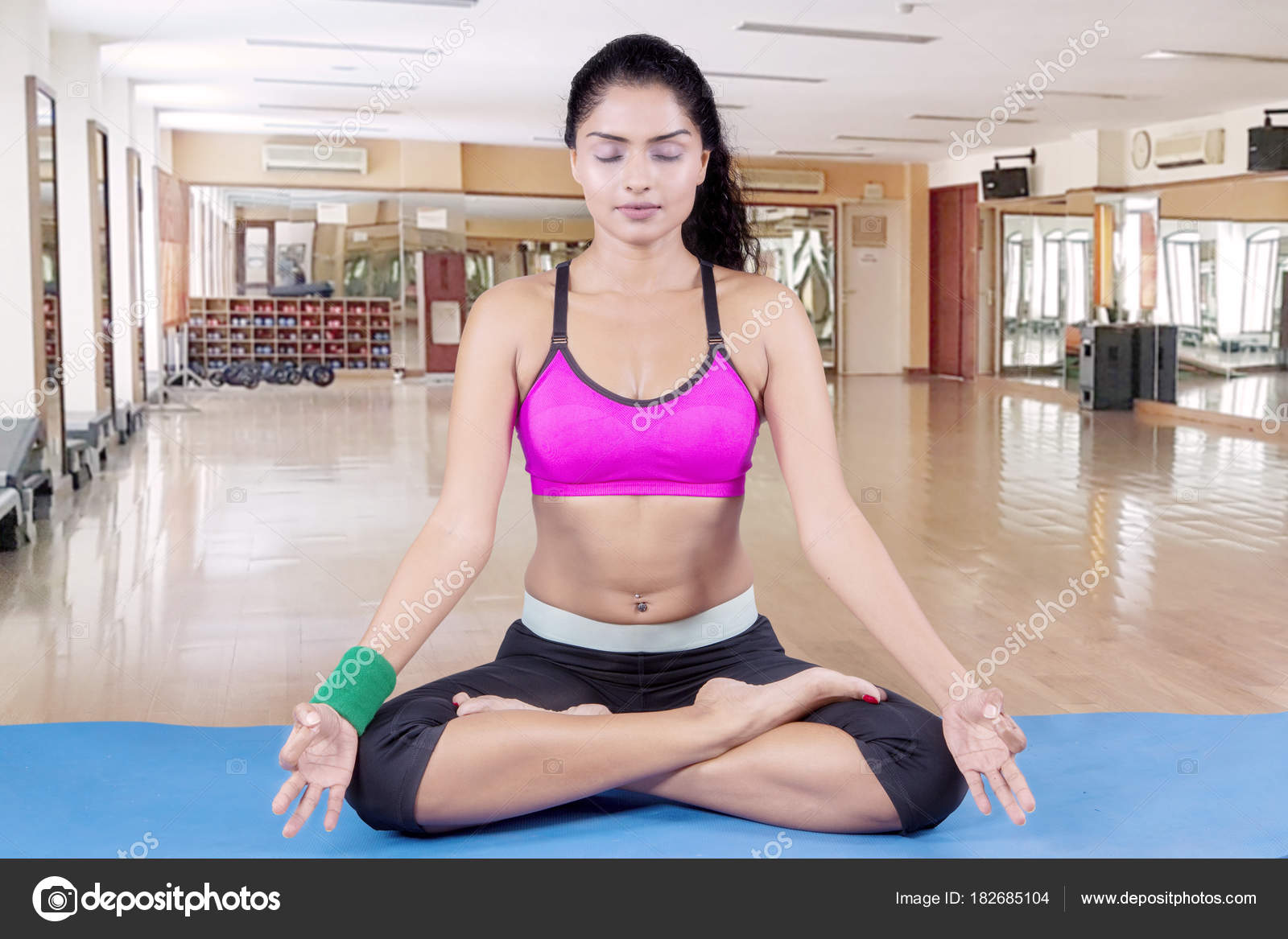 Indian Woman Meditating In The Fitness Center Stock Photo C Realinemedia 182685104