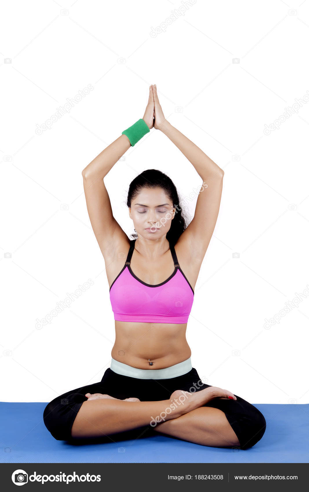 Indian Woman Practicing Yoga On Studio Stock Photo C Realinemedia 188243508