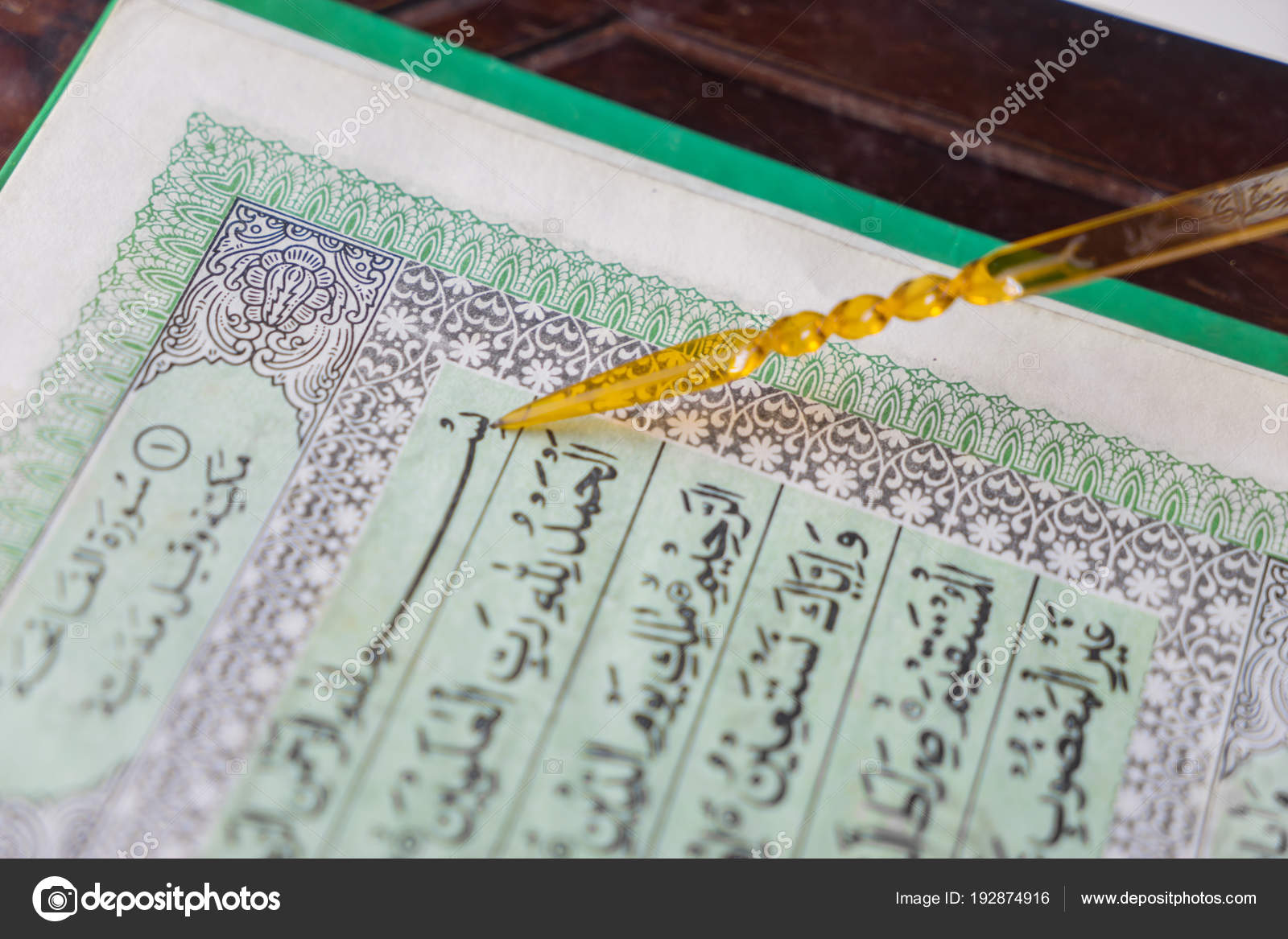 Quran pointer | Someone reads holy Quran with pointer stick
