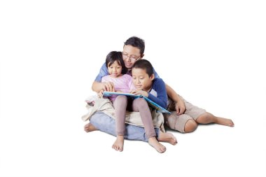 Handsome Asian man storytelling to his children