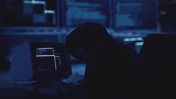 Masked hacker trying to attack the security server