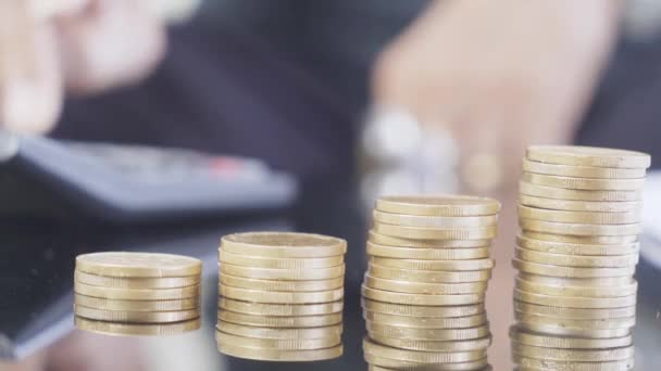 Coins with blurred background of old man counting