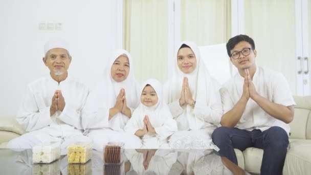 Muslim family showing a greeting hands at home