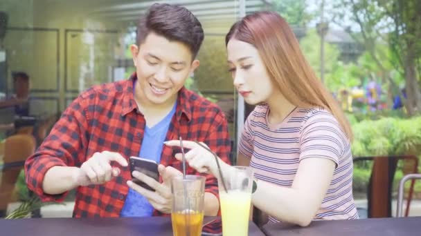 Portrait of young couple using digital tablet while enjoying leisure time together in cafe