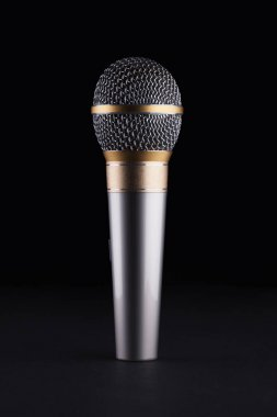 A wireless microphone on a black background