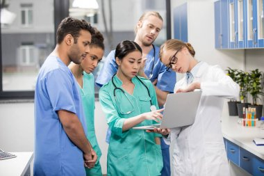 medical workers using laptop