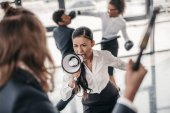 Fotografie businesswoman with megaphone screaming