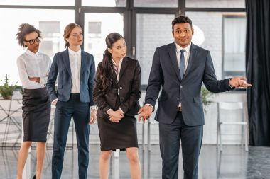 young businesspeople in formalwear at modern office