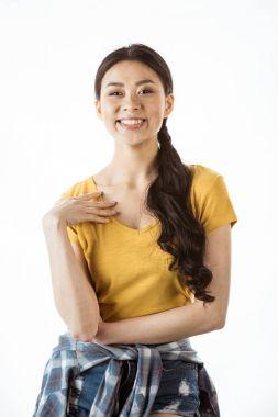 Happy asian girl looking at camera