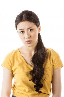 Young asian girl looking at camera