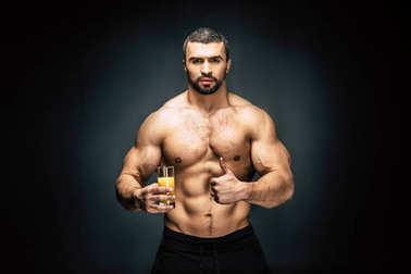 athletic man with glass of juice