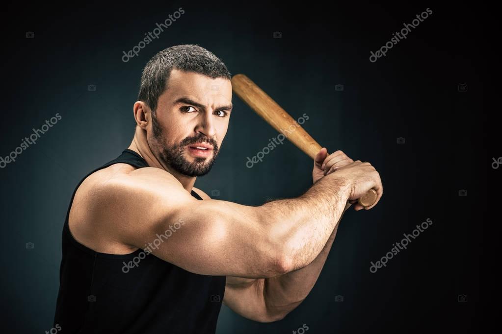 sportive man with baseball bat
