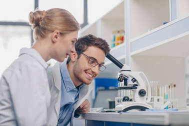 scientists working with microscope
