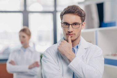 male pensive chemist