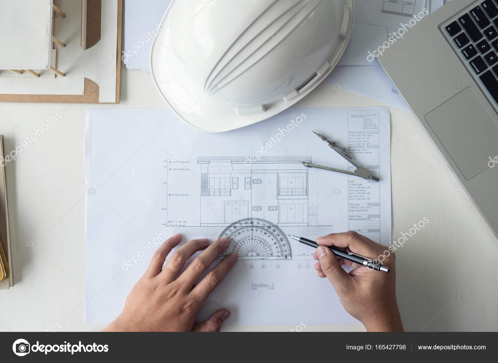 Architect working on blueprint engineer working with engineerin architect working on blueprint engineer working with engineering tools for architectural project on workplace construction concept building project malvernweather Image collections
