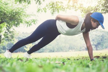 woman push-up exercise workout fitness doing outside on grass  i