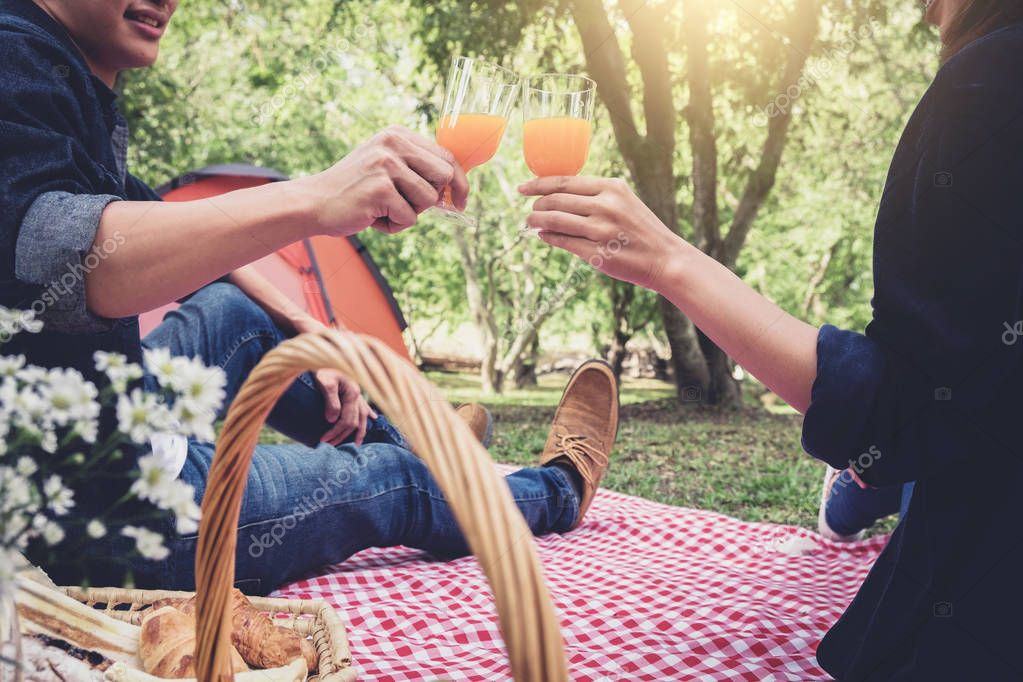Couple in love drink a orange juice on summer picnic, leisure, h