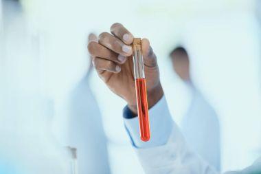 Scientist holding test tube
