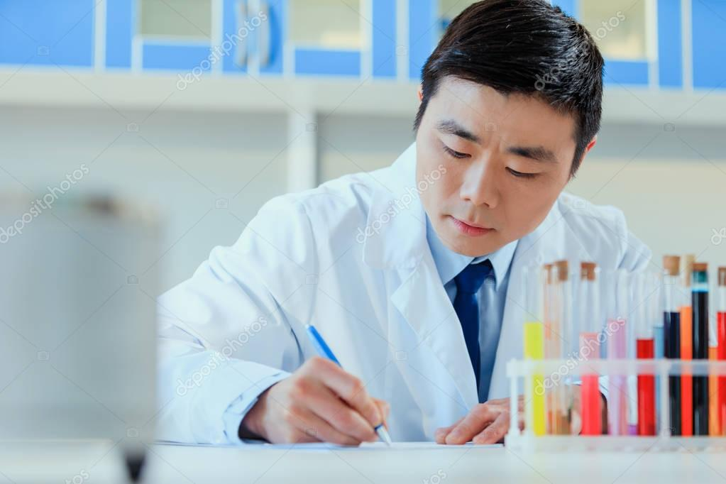 asian doctor working at testing laboratory